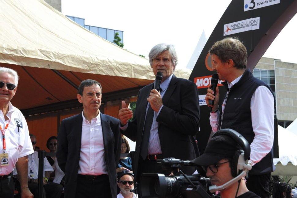 Pierre Fillon (à gauche), président depuis 2012 de l'Automobile Club de l'Ouest, organisateur des 24 Heures du Mans et Stéphane Le Foll, Maire du Mans, au lancement de la Parade des Pilotes, le vendredi 14 juin 2019, place des Jacobins.